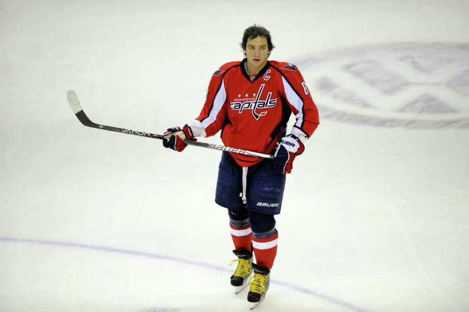 Washington Capitals left wing Alex Ovechkin (8), of Russia, looks on during warm ups before an NHL hockey game against the New York Islanders, Tuesday, Jan. 17, 2012, in Washington. (AP Photo/Nick Wass) Photo: Nick Wass / FR67404 AP