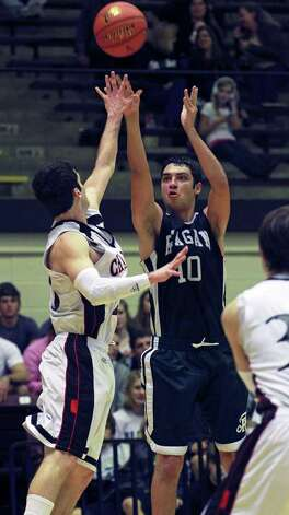 Reagan's Bryan Hardy cranks a 3-point shot for the Rattlers as Churchill beats Reagan 60-48 at Littleton Gym  on Tuesday, Jan. 24, 2012. Photo: Tom Reel,  Treel@express-news.net / © 2012 San Antonio Express-News  MAGS OUT; TV OUT; NO SALES; SAN ANTONIO OUT; AP MEMBERS ONLY; MANDATORY CREDIT; EFE OUT