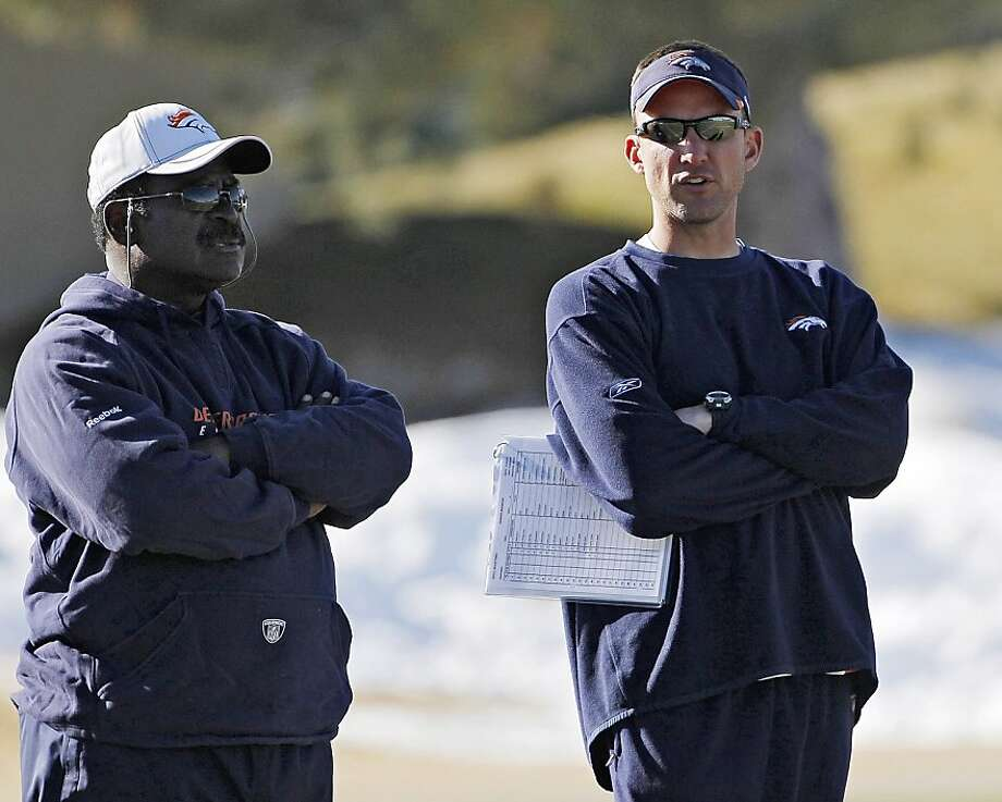 Denver Broncos defensive coach Dennis Allen, right, talks with defensive line coach Wayne Nunley during practice at the football team's training facility in Englewood, Colo., on Tuesday, Jan. 10, 2012. The Broncos are scheduled to play the New England Patriots in an NFL divisional playoff game on Saturday. (AP Photo/Ed Andrieski) Photo: Ed Andrieski, Associated Press