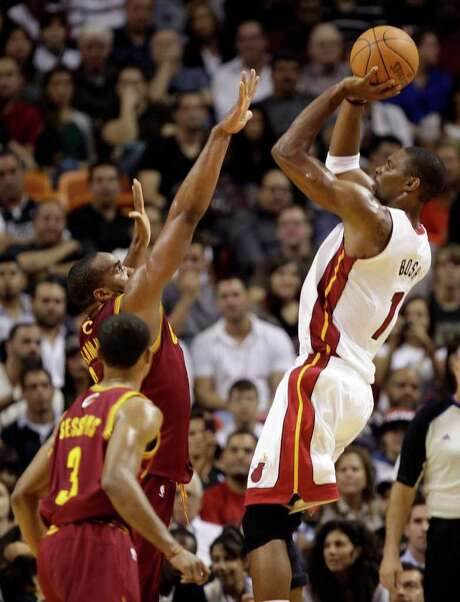 Cleveland defenders had no answer for Miami's Chris Bosh (1), who had 35 points in the Heat's win. Photo: Lynne Sladky / AP