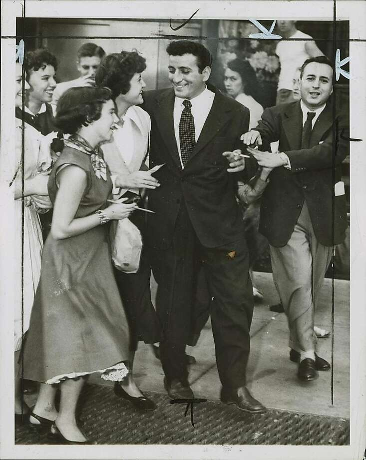 Tony Bennett leaves a performance at a Greenwich Village nightclub in New york in 1951. 10/4/1951 Photo: Associated Press