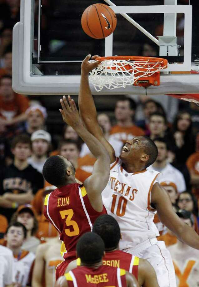 Texas' Jonathan Holmes (10) defends a shot by Iowa State's Melvin Ejim (3)during the second half of an NCAA college basketball game, Tuesday, Jan. 24, 2012, in Austin. Photo: Eric Gay, Associated Press