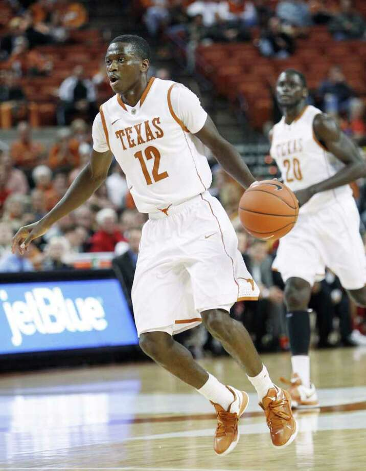 Texas' J'Covan Brown (14) moves the ball up court during the second half of an NCAA college basketball game against Iowa State, Tuesday, Jan. 24, 2012, in Austin. Photo: Eric Gay, Associated Press