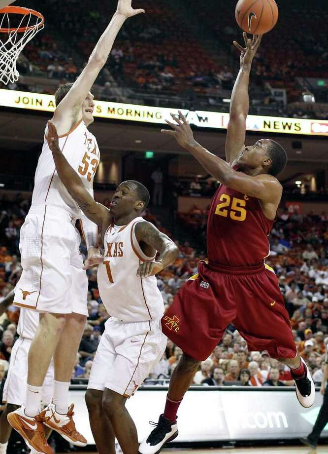 Iowa State's Tyrus McGee (23) shoot over Texas defenders  Clint Chapman (53) and Sheldon McClellan (1) during the first half of an NCAA college basketball game, Tuesday, Jan. 24, 2012, in Austin. Photo: Eric Gay, Associated Press