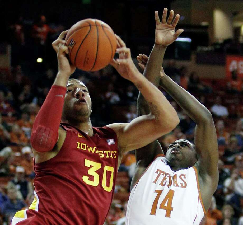 Iowa State's Royce White (30) is defended by Texas' J'Covan Brown (14) during the first half of an NCAA college basketball game, Tuesday, Jan. 24, 2012, in Austin. Photo: Eric Gay, Associated Press
