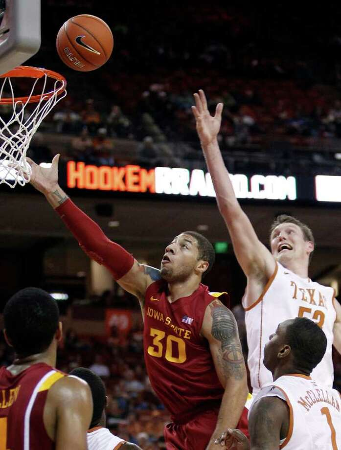 Iowa State's Royce White (30) shoots past Texas defenders Clint Chapman (53) and Sheldon McClellan (1) during the first half of an NCAA college basketball game, Tuesday, Jan. 24, 2012, in Austin. Photo: Eric Gay, Associated Press