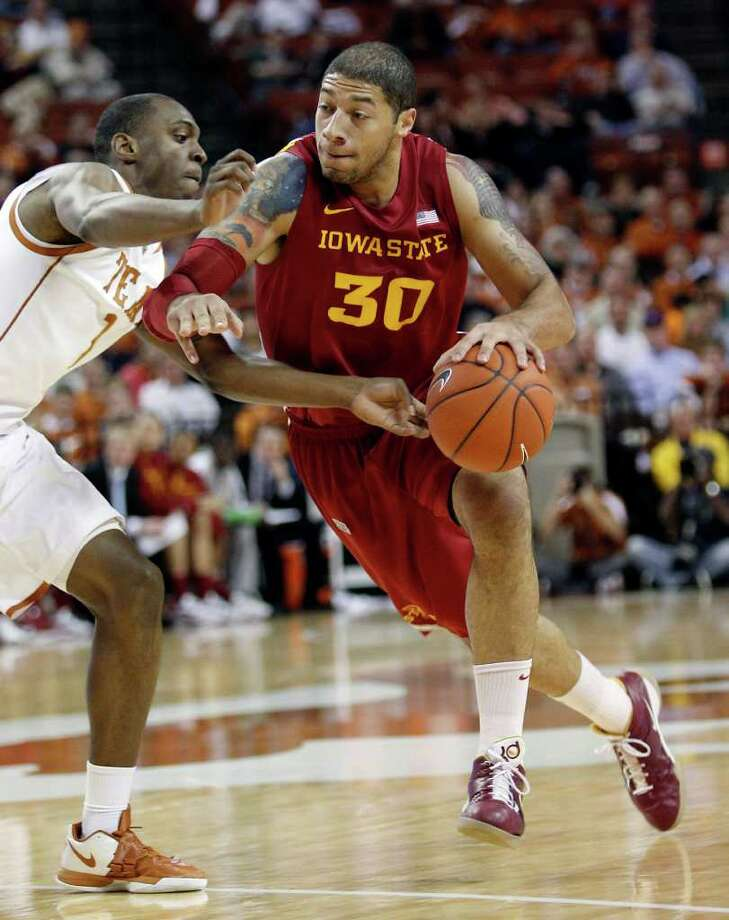 Iowa State's Royce White (30) drives past Texas' Sheldon McClellan (1) during the first half of an NCAA college basketball game, Tuesday, Jan. 24, 2012, in Austin. Photo: Eric Gay, Associated Press