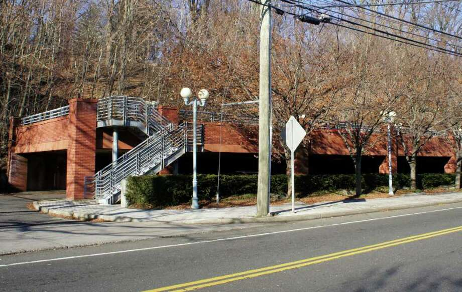 Greenfield Partners, a Norwalk-based commercial real estate firm, is seeking to add a third level to this parking deck that it owns on Wilton Road to facilitate its plans to revitalize the National Hall complex across the street. Photo: Paul Schott / Westport News