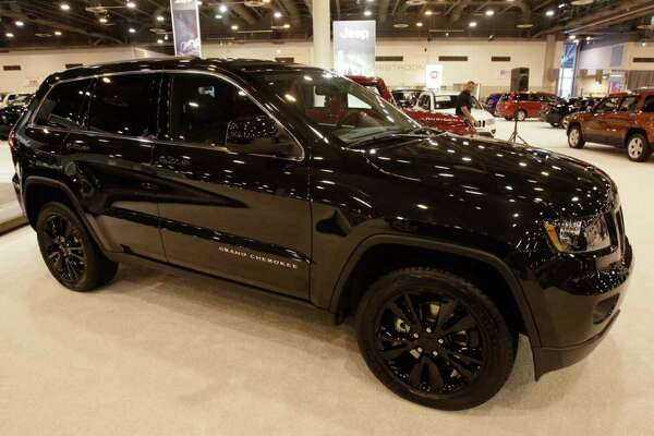 """The """"blacked out"""" look Jeep Grand Cherokee on display at the 2012 Houston Auto Show at Reliant Center, Tuesday, Jan. 24, 2012, in Houston.  This is the US debut of the concept Jeep Grand Cherokee that will later go into production. ( Melissa Phillip / Houston Chronicle )  NOTE---EMBARGO until 9am JAN 25"""