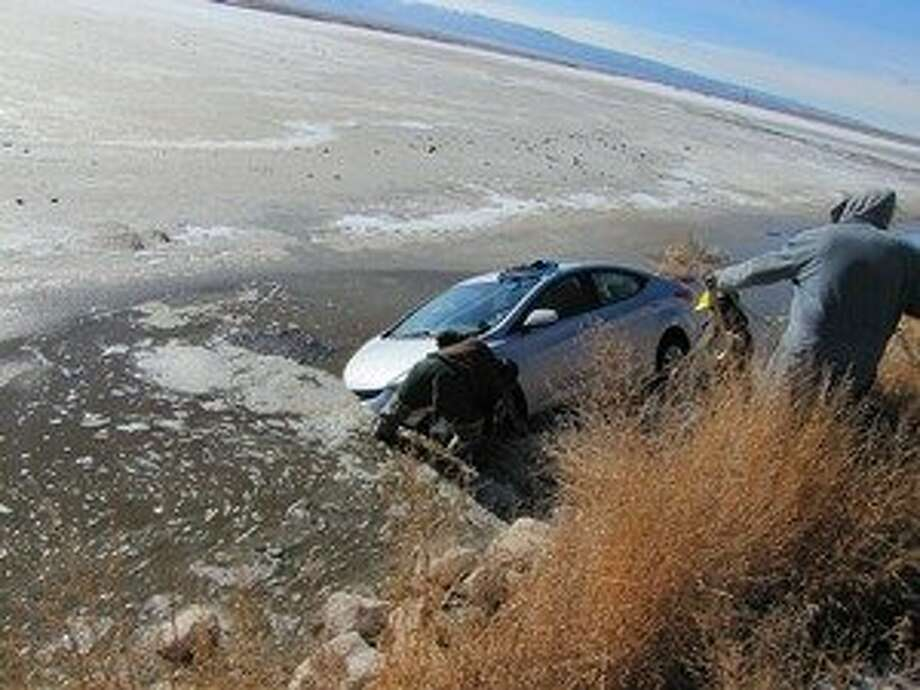 Lynn Keesler's rental car was stuck for several days in a drainage pond in southern Idaho. Photo: Handout