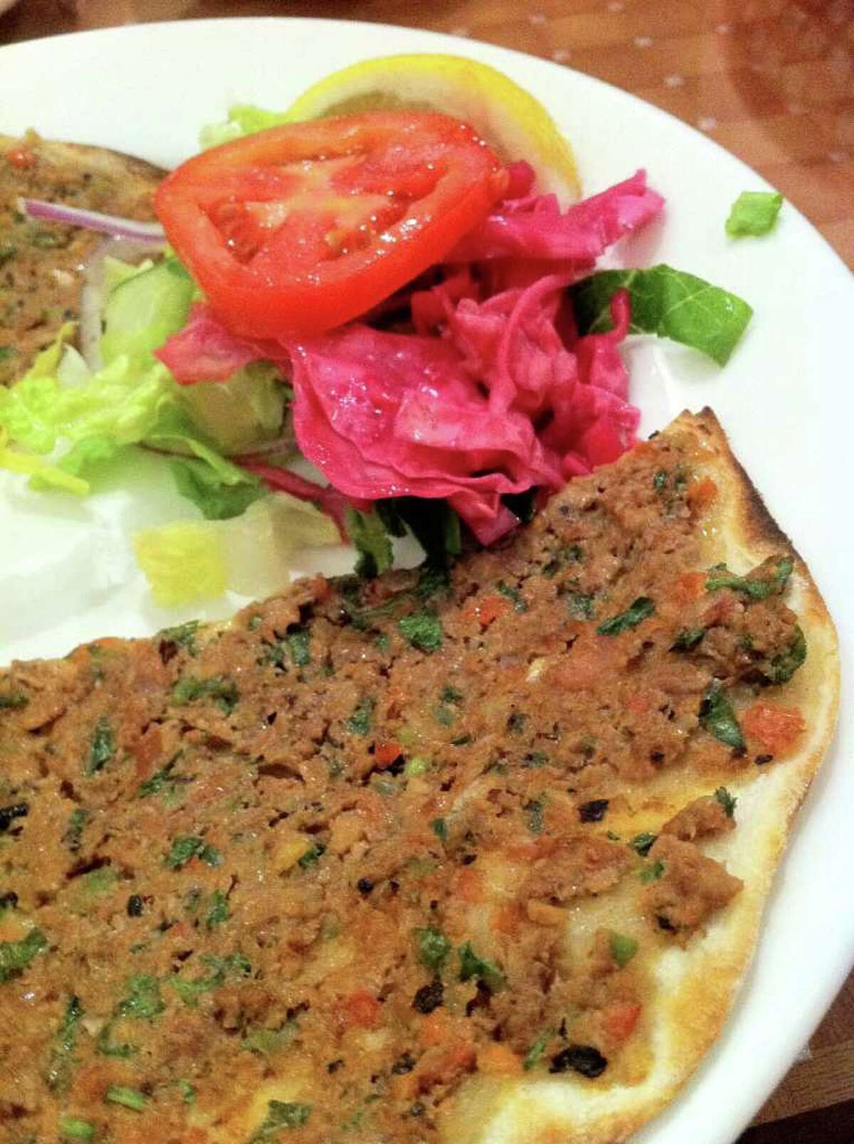 Istanbul Grill's lamacun is made with lamb, pine nuts and pickled cabbage salad.