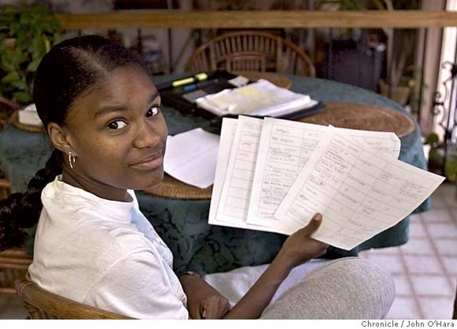 Richmond, CA.  At home, Ramine Cromartie-Thornton, thnks abut which school to attend, MIT, Duke or where ? She has made comparative lists about each school and the s�rrounding areas. Her Father, Barry Cromartie is with her in the kitchen. He is the planning director of AMerican Canyon  Photo/ John O'Hara Photo: John O'hara