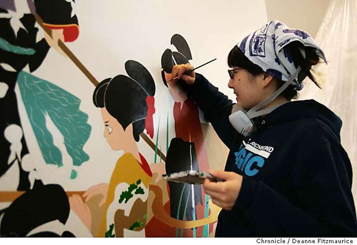 Famed Japanese artist Ai Yamaguchi paints a mural on the wall in the soon to be opened Shu Uemura cosmetics store on Fillmore Street. San Francisco Chronicle photo by Deanne Fitzmaurice