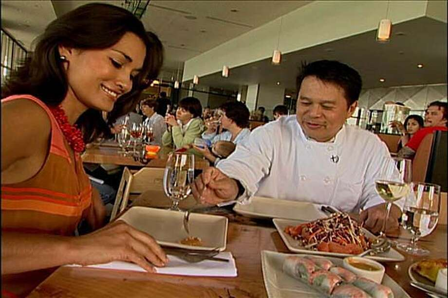"KRON's ""Pacific Fusion"" host, Brook Lee, with Slanted Door chef Charles Phan.  HANDOUT / COURTESY OF PACIFIC FUSION Living#Living#Chronicle#11/7/2004#ALL#2star#EX#0422450260"