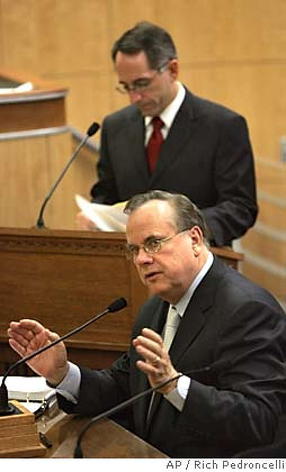 Attorney General Bill Lockyer, front, urges lawmakers to approve a measure that would require a serial number on bullets sold in California, during a hearing of the Senate Public Safety Committee at the Capitol in Sacramento, Calif., Tuesday, April 26, 2005. The bill, authored by state Sen. Joe Dunn, D-Garden Grove, back, was approved by a 4-2 vote. (AP Photo/Rich Pedroncelli)