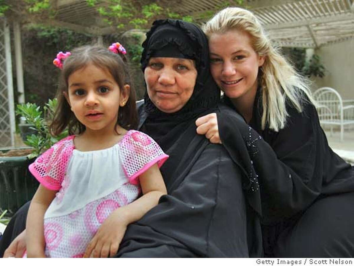 BAGHDAD, IRAQ - APRIL 15: (NO MAGS, , MANDATORY PHOTO CREDIT) In this handout photo, American humanitarian aid worker Marla Ruzicka (R) poses for a portrait with an Iraqi family her organization, the Campaign for Innocent Victims in Conflict (CIVIC) recently helped, on April 15, 2005 in Baghdad, Iraq. According to reports Ruzicka was apparently killed by a suicide bomber targeting a nearby American military convoy on the airport road on April 16 in Baghdad. (Photo by Scott Nelson/World Picture News via Getty Images) *** Local Caption *** Marla Ruzicka Ran on: 04-18-2005 Marla Ruzicka poses April 15 with an Iraqi family helped by the organization she founded, Campaign for Innocent Victims of Conflict. Ran on: 04-18-2005 Marla Ruzicka poses April 15 with an Iraqi family helped by the organization she founded, Campaign for Innocent Victims of Conflict. Ran on: 04-24-2005 Marla Ruzicka was killed on April 15 by a suicide car bombing on the airport road in Baghdad.