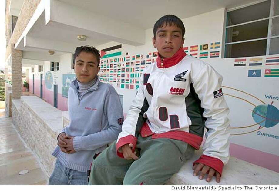 Ithar Sael, 14 (right) and Ahmed Ali, 14, (left) at the Hope Flowers School in El-Khadr village near Bethlehem, which is facing a demolition order.  By David Blumenfeld/Special to The Chronicle Ran on: 04-16-2005  Fourteen-year-olds Ahmed Ali (left) and Ithar Sael relax at the Hope Flowers School, which faces problems from both the Palestinian Authority and Israeli government.