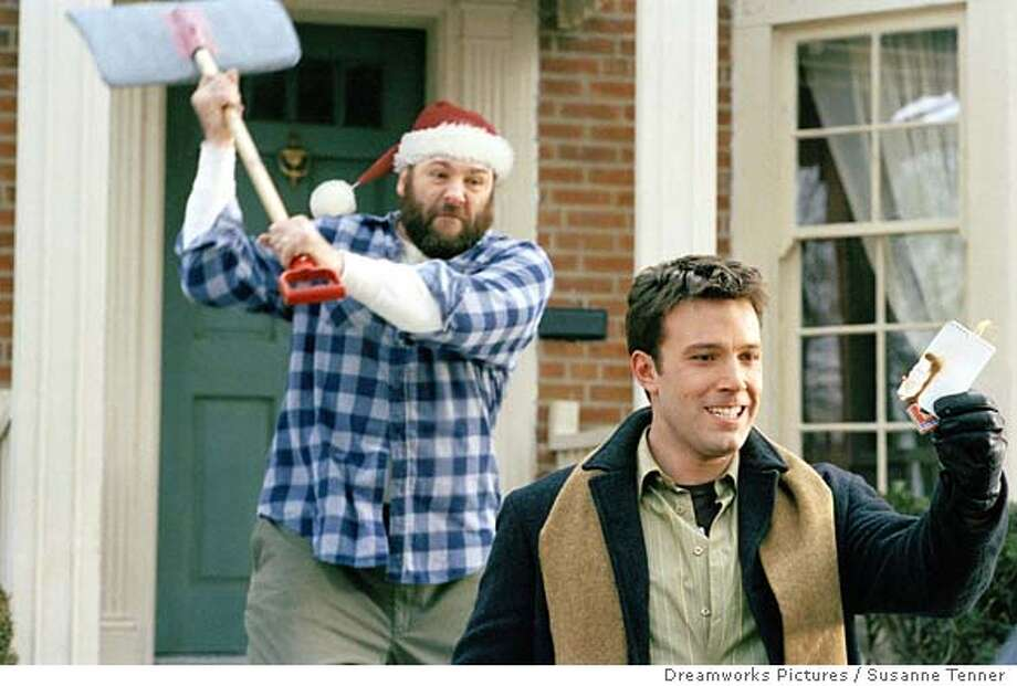"Drew Latham (Ben Affleck, right) is unaware that he is about to get a rather cold Christmas greeting from Tom Valco (James Gandolfini) in DreamWorks Pictures comedy ""Surviving Christmas."" (Dreamworks Pictures/Susanne Tenner) Datebook#Datebook#Chronicle#10/22/2004#ALL#Advance##0422419513 Photo: SUSANNE TENNER"