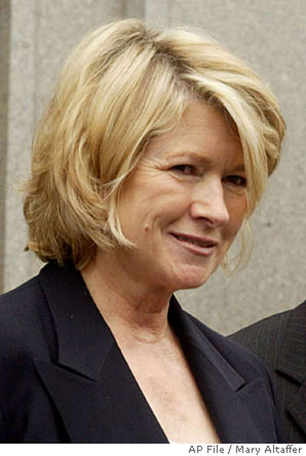 """**FILE** , left, leaves Manhattan Federal court accompanied by a U.S. Marshal, Wednesday, July 28, 2004 in New York. reported to prison early Friday, Oct. 8, 2004 in Alderson, W.Va., to begin serving a five-month sentence for lying about a stock sale, telling supporters she was looking forward to returning to work in March and enjoying """"many brighter days ahead."""" (AP Photo/Mary Altaffer, File)"""