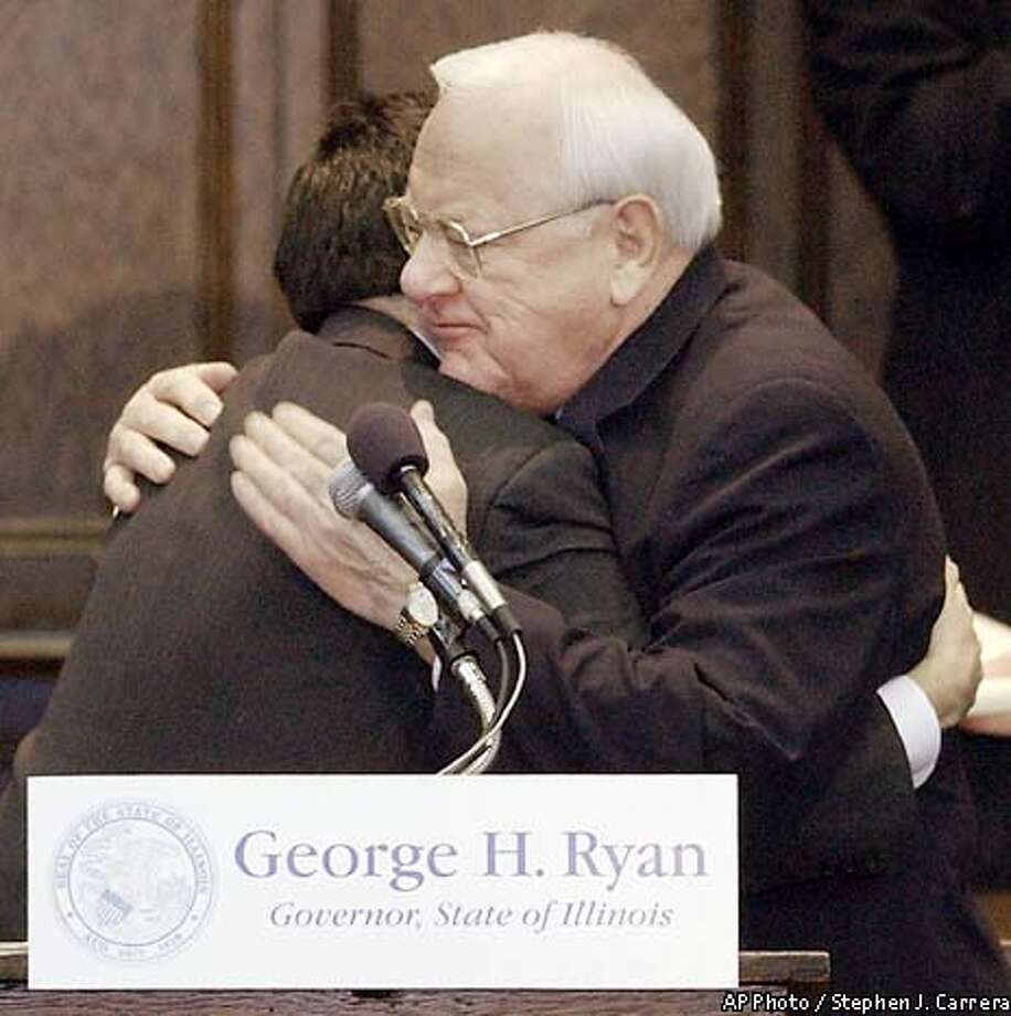 ** RETRANSMITTING TO CORRECT YEAR TO 2003 NOT 2002 **Illinois Gov. George Ryan, right, and Larry Marshall, leagal director of the Center for Wrongfull Convictions at Northwestern University Law School embrace before Ryan speaks at the school Saturday Jan. 11, 2003 in Chicago. Gov. George Ryan announced Saturday he would clear Illinois death row by commuting the sentences of all 156 condemned inmates, saying the states death penalty process was as capricious and arbitrary as who gets hit by a bolt of lightning. (AP Photo/Stephen J. Carerra) Photo: STEPHEN J. CARRERA
