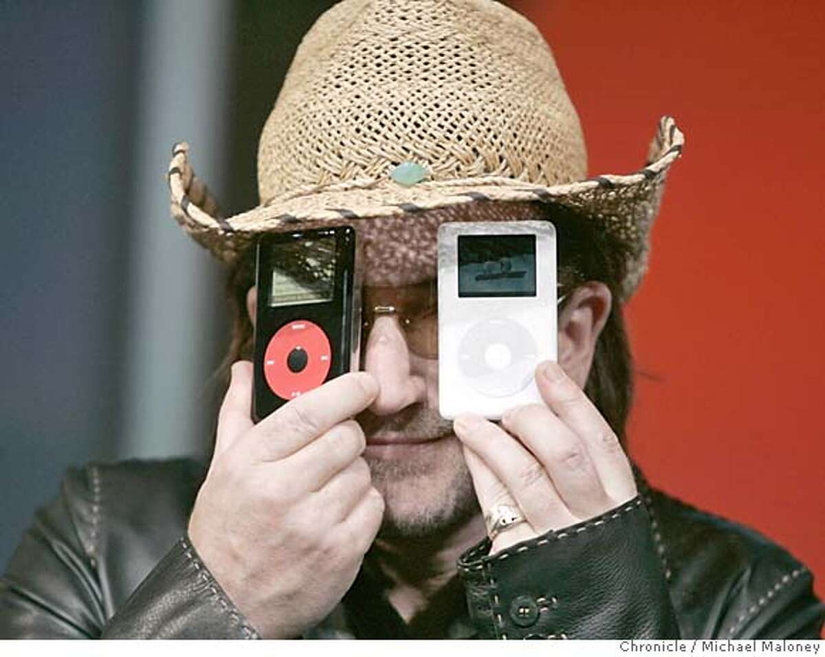 APPLE27_140_MJM.jpg After the press conference and during a photo op, Bono displays the 2 new iPods. Apple Computer unveiled a color screen version of its popular iPod music player in addition to a black and red special addition version in partnership with the rock band U2. At a press conference in San Jose, Apple CEO Steve Jobs showed off both versions of the iPod and Bono and The Edge of U2 performed 2 new songs from their upcoming album. Photo by Michael Maloney / San Francisco Chronicle MANDATORY CREDIT FOR PHOTOG AND SF CHRONICLE/ -MAGS OUT