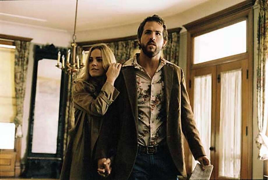 "Melissa George and Ryan Reynolds in the remake of ""The Amityville Horror."" Photo courtesy of MGM"