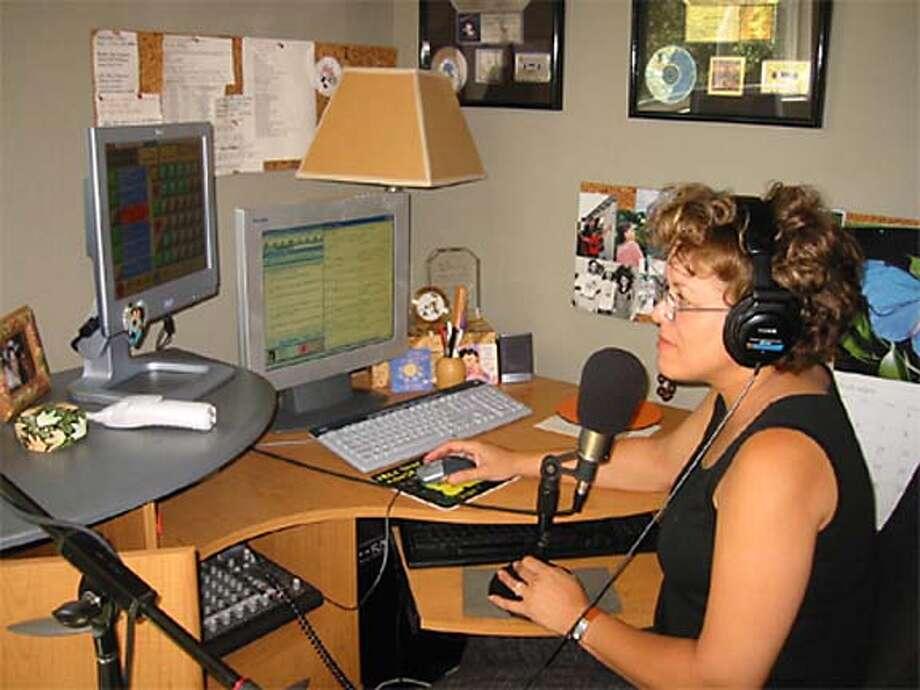 Radio personality Maria Lopez doing voice-tracking. Datebook#Datebook#SundayDateBook#10-17-2004#ALL#Advance##0422396939