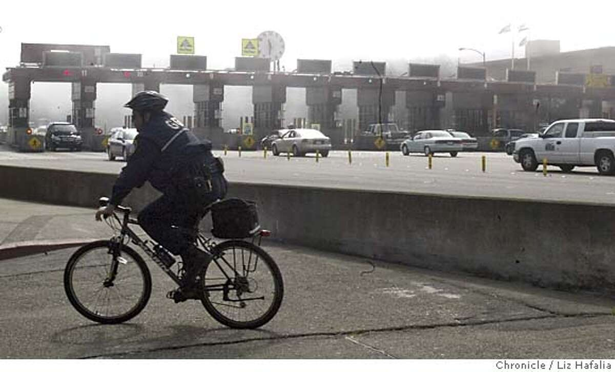 Patrol officer Miguel Galdamez just spent two hours of the morning patrolling the Golden Gate bridge walkway. The Golden Gate Bridge district board will decide Friday whether to spend $2 million that they don't have studying a suicide barrier. Shot in San Francisco on 3/9/05.