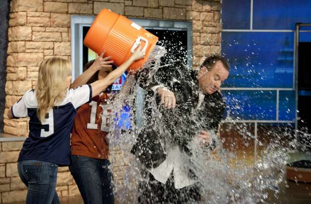 Delaine Mathieu, Elsa Ramon pour a bucket of water over sportscaster Don Harris' head on Super Bowl promo. Photo: Courtesy WOAI