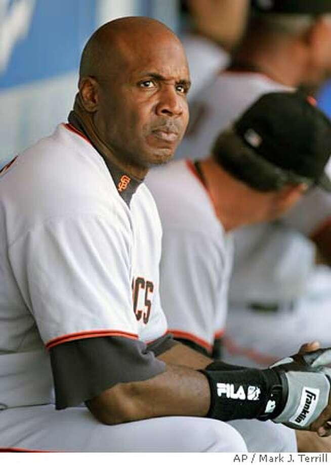 San Francisco Giants' Barry Bonds looks on from the dugout prior to their game against the Los Angeles Dodgers, Sunday, Oct. 3, 2004, in Los Angeles. (AP Photo/Mark J. Terrill) Metro#MainNews#Chronicle#10/16/2004#ALL#5star##0422392112 Photo: MARK J. TERRILL