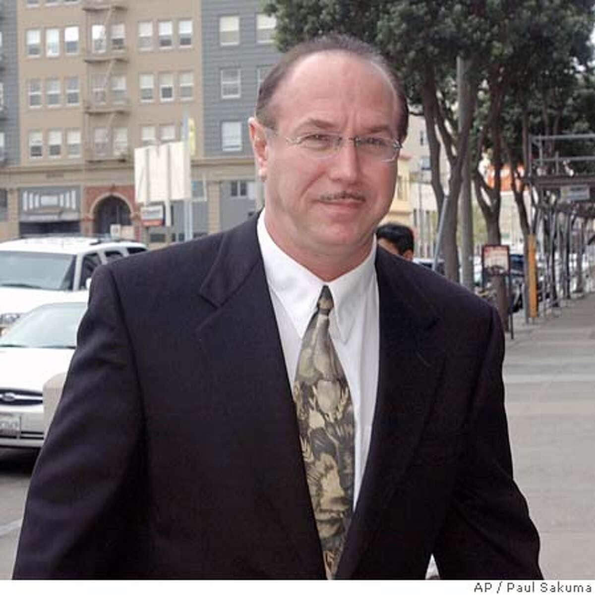 ** FILE ** Victor Conte, San Francisco Giants Barry Bonds' nutritional adviser and founder of the Bay Area Laboratory Co-Operative (BALCO) arrives at the Federal Courthouse in San Francisco, in this March 26, 2004 photo. The lack of a plea agreement between prosecutors and Conte, accused of distributing steroids to top athletes may make it more difficult for anti-doping authorities to build drug cases against track stars. Conte, founder of the Bay Area Laboratory Co-Operative, and his attorneys met with federal authorities for about three hours Thursday, June 4, 2004, in San Jose, Calif., but did not reach any deal. (AP Photo/Paul Sakuma) Ran on: 06-16-2004 Victor Conte says he could help in an investigation of the use of performance- enhancing substances. ALSO RAN: 06/28/2004 Ran on: 06-28-2004 Ran on: 06-28-2004 Ran on: 06-28-2004 Tim Montgomery, left, testified that the steroid distributed by Victor Conte, right, did not enhance his performance. A March 26, 2004 file photo Nation#MainNews#Chronicle#10/16/2004#ALL#5star##0421808615