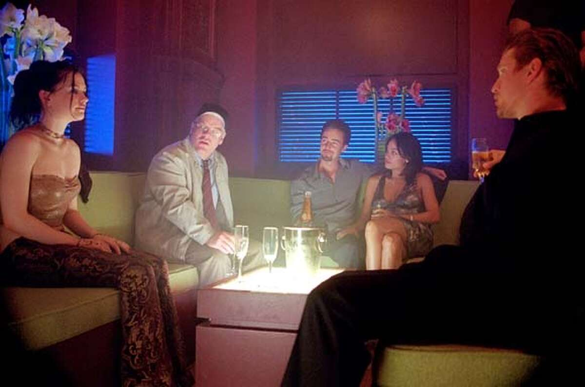 """In Spike Lee's """"25th Hour,"""" Monty Brogan (played by Edward Norton) rounds up his friends for one last outing to a swank nightclub the night before he starts a seven-year prison term for drug crimes. From left: Anna Paquin, Philip Seymour Hoffman, Norton, Rosario Dawson and Barry Pepper."""