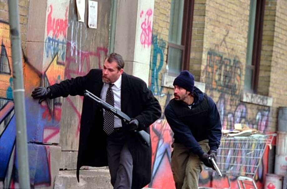 "Ray Liotta's Henry Oak, left, and Jason Patric's Nick Tellis team up against the bad guys who killed Oak's friend in ""Narc."""