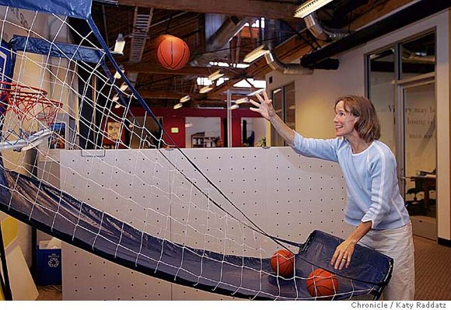MISSY041_rad.jpg SHOWN: Missy Parks takes a small basketball break between meetings. The basketball spot, as well as many other play areas, are right in the office. She believes very strongly in the value of play, and her employees heartily concur. In 1989 Missy Parks founded Title IX Sports in Emeryville, CA., one of the first companies that specializes in sports attire for women. Now she's sending out 20 million catalogues and about to open her 6th retail store. Katy Raddatz / The Chronicle Photo: Katy Raddatz