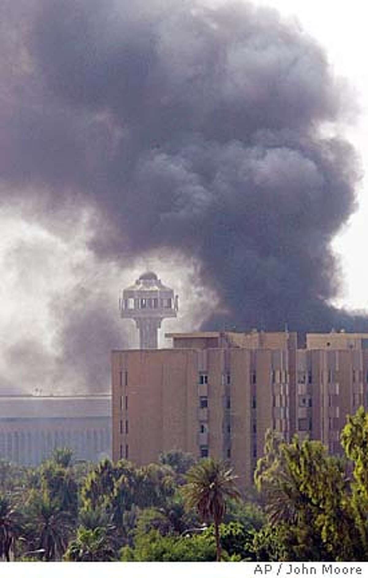 Heavy smoke rises following two explosions in the heavily fortified Green Zone in Baghdad, Iraq Thursday, Oct. 14, 2004. The Green Zone is home to the U.S. Embassy and Iraqi government offices.(AP Photo/John Moore)