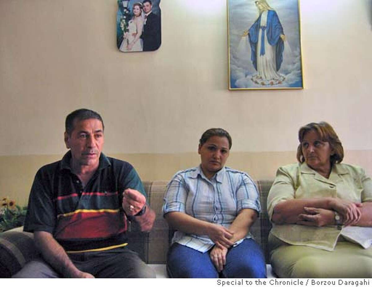 Behnam Farho, left, discusses his plans to leave Iraq after the kidnappin of his niece, Mayada Fais Farho, center. Serma Wiya is Mayada's mother. By: Borzou Daragahi / Special to The Chronicle