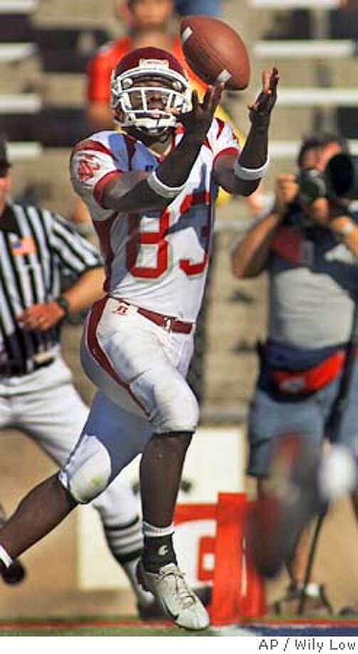 Washington State's Jason Hill (83) catches a pass in the end zone for a touchdown against Arizona in the fourth quarter in Tucson, Ariz., Saturday, Sept. 25, 2004. (AP Photo/Wily Low) Ran on: 10-15-2004  WSU's Jason Hill, formerly of Sacred Heart Cathedral, has eight TDs in five games. Photo: WILY LOW
