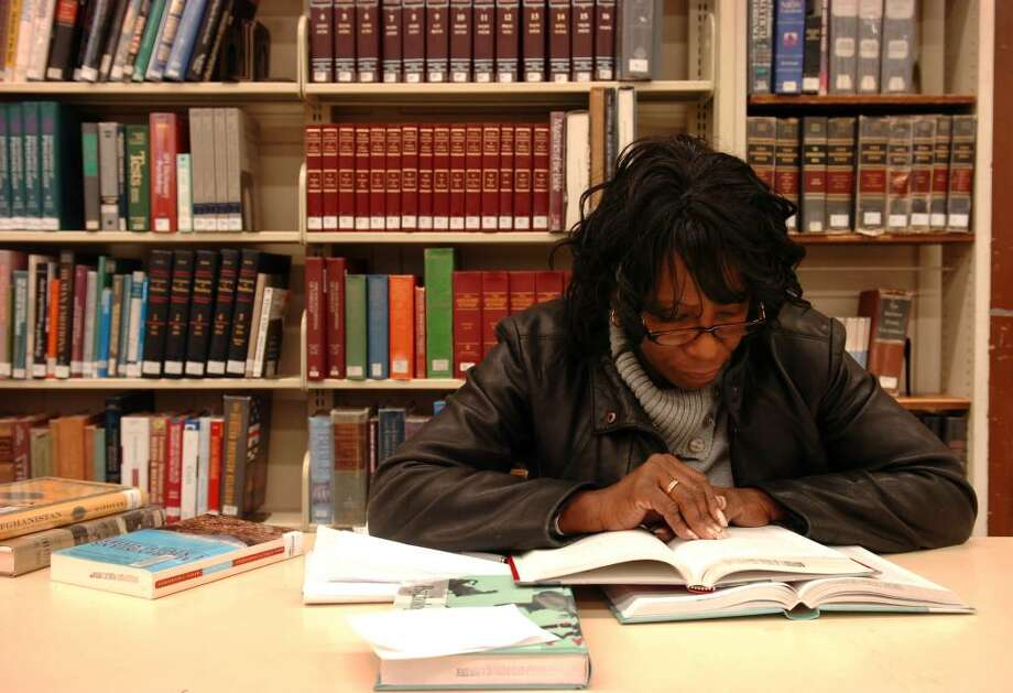 Dianne Cummings, of Bridgeport, does research for her human services studies at Springfield College in the reference department of the main Burroughs-Saden branch of the Bridgeport Public Library, in Bridgeport, Conn. on Oct. 28th, 2009. Photo: Ned Gerard / Connecticut Post