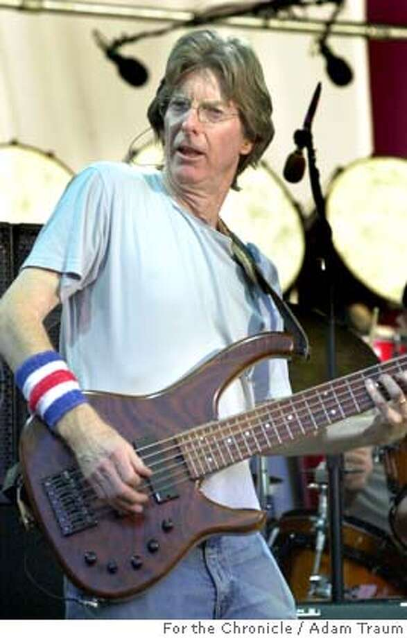 The Grateful Dead bassist, Phil Lesh plays with the band at Shoreline Amphitheater June 26, 2004. The band features Bob Weir on guitar and vocals, Phil Lesh on bass, Mickey Hart on drums, Bill Kreutzmann on Drums, Warrne Haynes on guitar and vocals, Jimmy Herring on guitar and Jeff Chimenti on keyboards.  Event on 6/27/04 in Mountain View. Adam Traum / The Chronicle Photo: Adam Traum