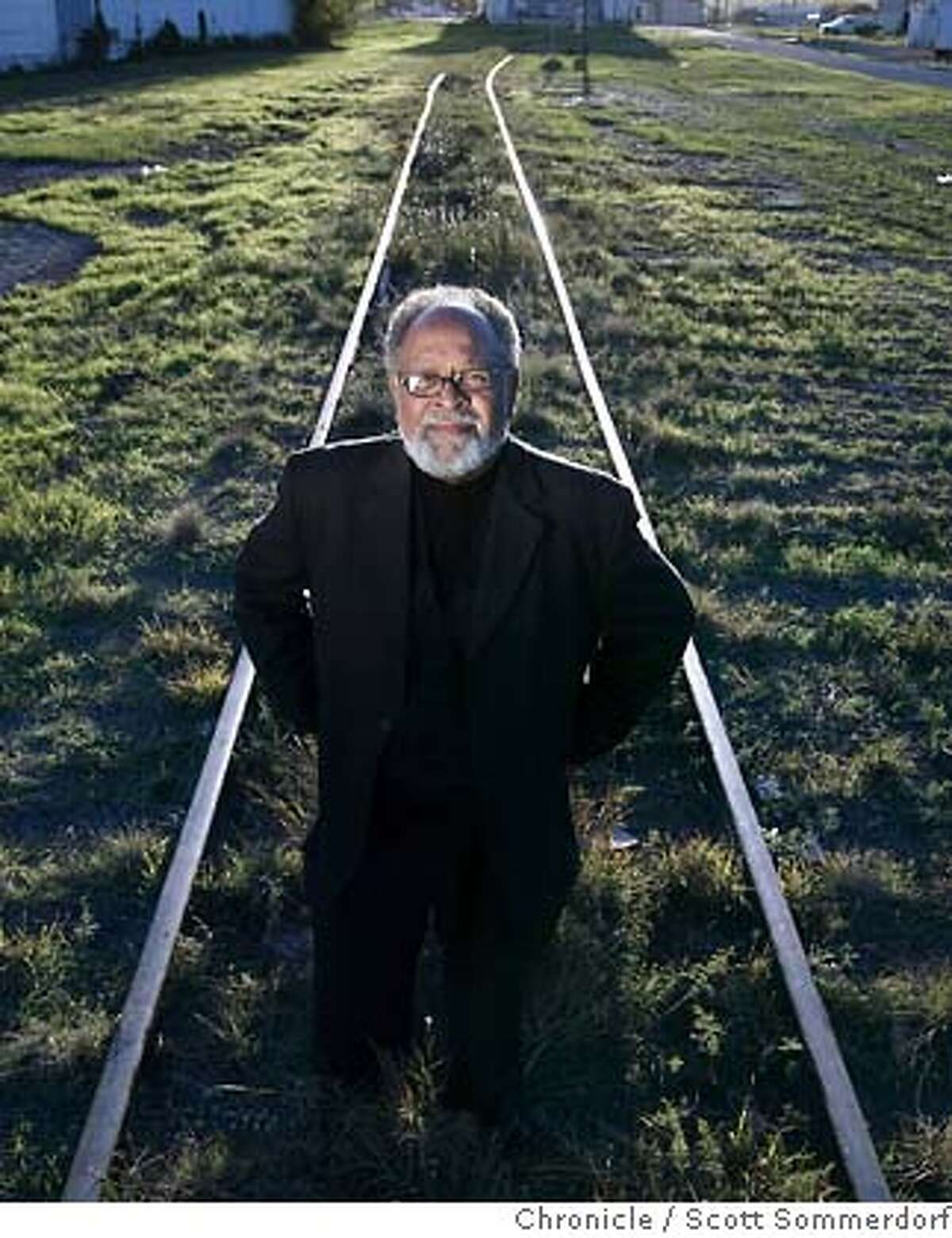 GLIDE minister Cecil Williams stands on the tracks that divided the black and white parts of town in San Angelo, Texas when he was a booy growing up there. He held a press conference on this spot during his visit to his hometown to bring attention to the racial divide that still remains in that place. SF CHRONICLE PHOTO BY SCOTT SOMMERDORF