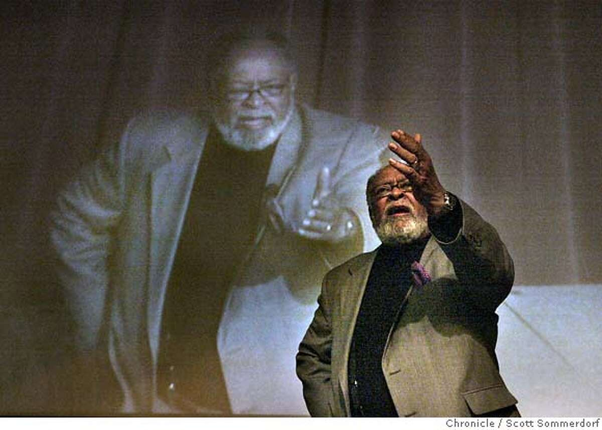 Cecil Williams and his larger-than-life (projected closed-circuit TV) image are shown addressing a question during a question and answer forum held at Angelo State University in San Angelo. The forum was held to address some of the issues about race in San Angelo. Syndicated columnist Bill Maxwell was the moderator of the discussion. SF CHRONICLE PHOTO BY SCOTT SOMMERDORF