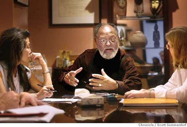 Cecil Williams speaks during a meeting of the Glide Board on August 15th, 2003. To the left is Janice Mirikitani (Cecil's wife, and also a board member) and to the right is Amy Errett, another Glide board member. GLIDE  SF CHRONICLE PHOTO BY SCOTT SOMMERDORF Photo: SCOTT SOMMERDORF