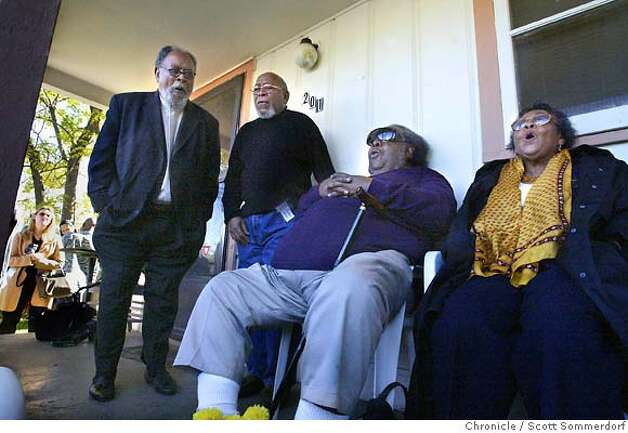 """Rev. Cecil Williams (far left) sings """"Swing Low Sweet Chariot"""" on the porch of the home that is on the site of Cecil's boyhood home in San Angelo, Texas. The other family members are from left to right; Claudius Williams, Cuney Earl Williams Jr., and sister Johnnie Cavanaugh. The family often sang on the porch in the old days. After feeling the nostalgia of the place, they spontaneously decided to sing there near the end of a press conference held on the site of the old house. SF CHRONICLE PHOTO BY SCOTT SOMMERDORF Photo: Scs"""