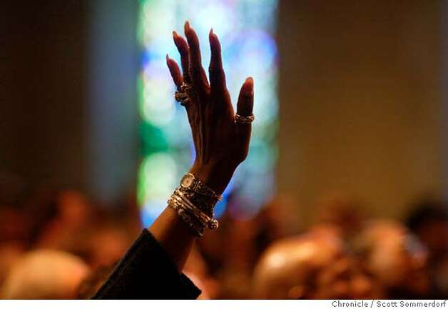 A detail of a woman's hand raised in praise during a service at Glide memorial. The congregation at Glide Memorial is a diverse one. The Glide Ensemble often get the room rocking with their mix of gospel and rock and roll. Here the congregation sings and dances. SF CHRONICLE PHOTO BY SCOTT SOMMERDORF Photo: Scs