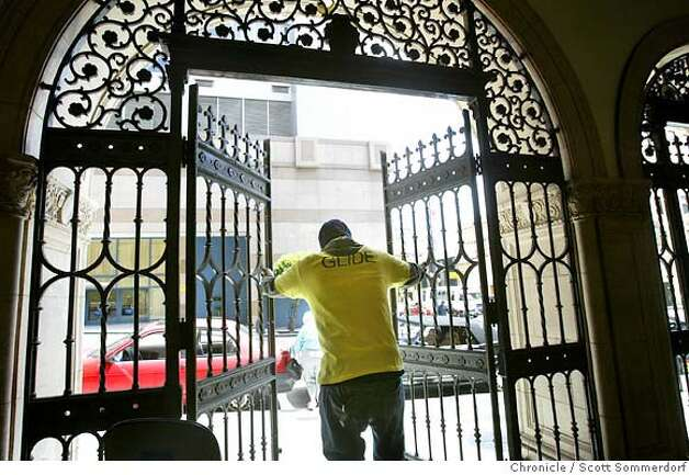 Security guard Jamal Victoria (cq) opens the side gates on Taylor Street at Glide Memorial after a service.  SF CHRONICLE PHOTO BY SCOTT SOMMERDORF Photo: Scs