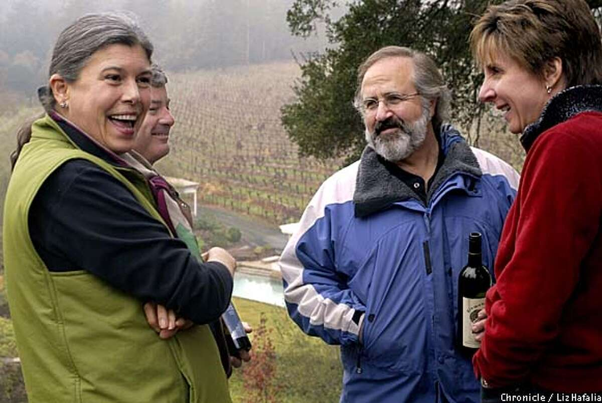 Diamond: Dawnine Dwyer (left, front) and Hal Taylor (left, back) talk wine at at Diamond Creek Vineyards with Phil Steinschriber (middle) and Maureen Taylor (right). Chronicle photo by Liz Hafalia