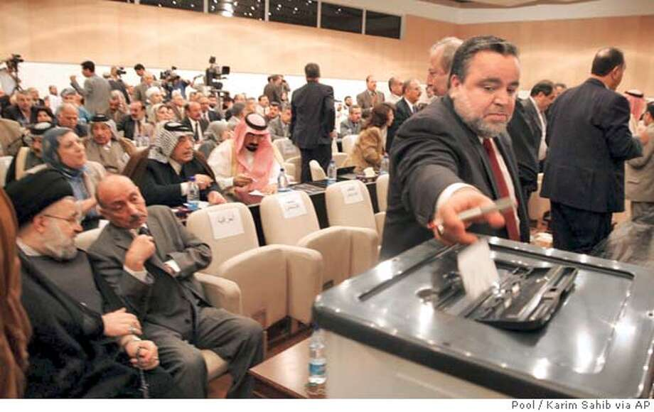 Iraqi Industry Minister Hajim al-Hassani, a Sunni Arab, casts his vote at the National Assembly session in Baghdad, Iraq, Sunday, April 3, 2005. Iraqi lawmakers elected al-Hassani as parliament speaker Sunday, ending days of deadlock and moving forward on forming a new government two months after the country's historic elections. (AP Photo/Karim Sahib, Pool) Photo: KARIM SAHIB