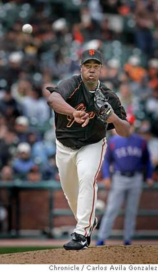 GIANTS04_001_CAG.JPG  Giants' starting pitcher, Jerome Williams, throws to first on a pick off attempt in the bottom of the fifth inning. The San Francisco Giants played the Texas Rangers at SBC Park in San Francisco, Ca., on Sunday, April 3, 2005. The Giants won 7-4.  Photo by Carlos Avila Gonzalez / The San Francisco Chronicle  Photo taken on 4/3/05 in San Francisco, CA. MANDATORY CREDIT FOR PHOTOG AND SAN FRANCISCO CHRONICLE/ -MAGS OUT Photo: Carlos Avila Gonzalez