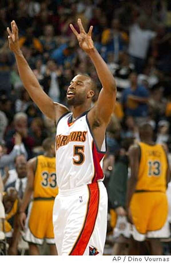 Golden State Warriors' Baron Davis celebrates teammate Mike Dunleavy's 3-point shot late in the fourth quarter that put the game out of reach against the Seattle SuperSonics, Sunday, April 3, 2005, in Oakland, Calif. The Warriors won 101-92.(AP Photo/Dino Vournas) Photo: DINO VOURNAS
