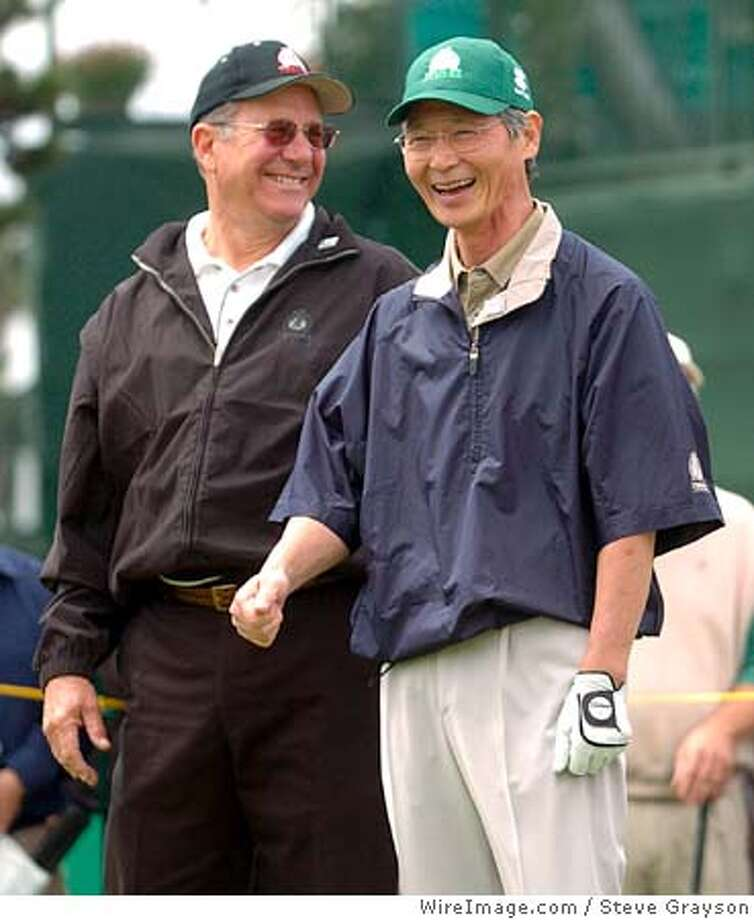 "Jay Rohrer shares a laugh with Hideo Ito, Chairman of Toshiba America Inc. during a ceremonial tee at The Champions' Tour 2005 Toshiba Classic's ""Drive To a Billion Charity Campaign"" at the Newport Beach Country Club in Newport Beach, California March 16, 2005. Credit: Steve Grayson/WireImage.com Photo: Steve Grayson/WireImage.com"